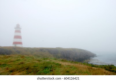 Brier Island Lighthouse, also known as Western Light, in the fog. Located in Westport, Brier Island, Nova Scotia, Canada, it is at the westernmost point in Nova Scotia.