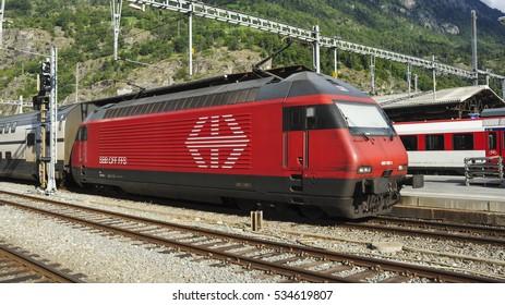 BRIG, VALAIS/SWITZERLAND - September 6, 2015. Class Re 460 electric loco heads passenger train at Brig station, Switzerland