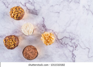 Brigadeiro is a common Brazilian dessert. Top view background Valentine's Day, Christmas or New Year.