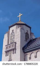 Brigantine, NJ / USA - July 16 2020: Portion of St. Thomas the Apostle Church set against a blue sky.