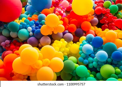 Bright abstract background of jumble of rainbow colored balloons celebrating gay pride - Shutterstock ID 1100995757