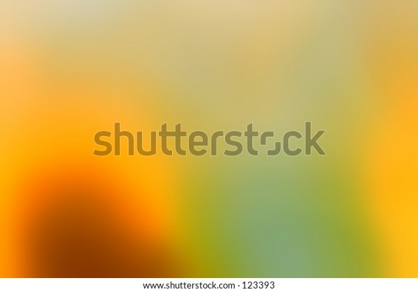 Bright abstract background in rich gold, yellow and green tones of blurred light