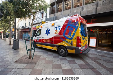 Bright ambulance in the street of Madrid, Spain 2018-08-05