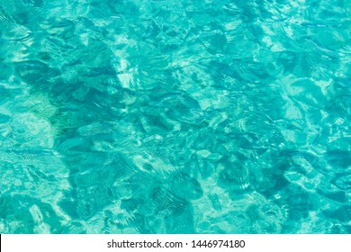bright aquamarine and white ripple tropic sea water surface simple background photography foreshortening from above, copy space