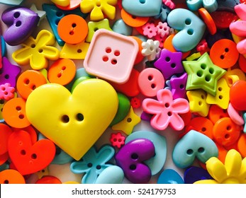 Bright assorted buttons in mix colors, crafts background