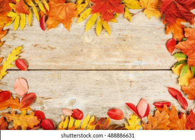 Bright autumn leaves old wooden surface with copy space