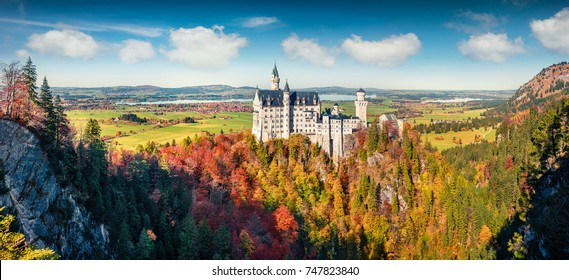 Bright autumn panorama of Neuschwanstein Castle (Schloss Neuschwanstein) in  in Fussen Germany. Colorful morning scene in Bavarian Alps, Germany, Europe. Traveling concept background.