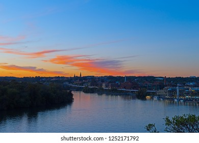 Bright autumn sunset over Georgetown waterfront in Washington DC, USA. Urban US capital panorama along Potomac River.