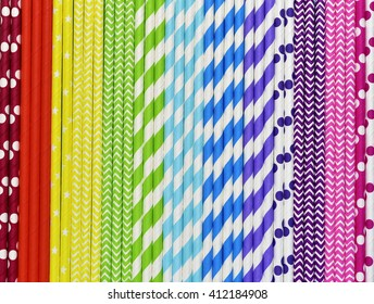 Bright background of colorful paper straws in rainbow colors.