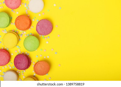 Bright background with a rows of macaroons and copy space