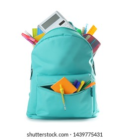 Bright backpack with school stationery isolated on white