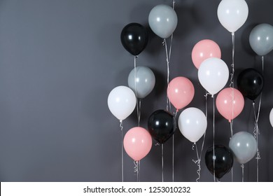 Bright balloons near color wall. Space for text