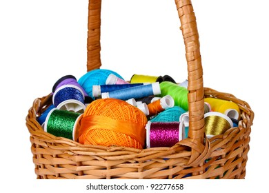 bright balls of  thread in basket isolated on white