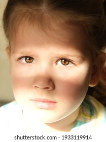 Bright beam of light illuminates part of the little girl's face and shadow covering her beautiful eyes depicting a face mask. Concept of unknown and extraordinary child's soul and inner world
