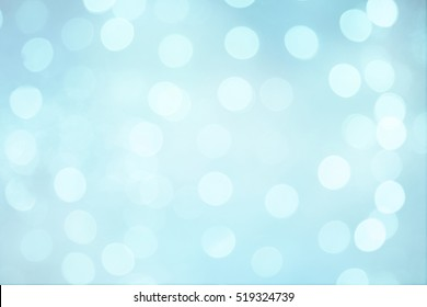 Bright Beautiful Abstract Blue White Background with Bokeh circles. Blurred Soft Texture with particles. Light spots on pale blue background, defocused