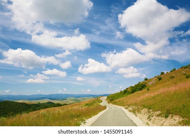 Bright beautiful day on mountain road, colorful environment during summer.  - Shutterstock ID 1455091145