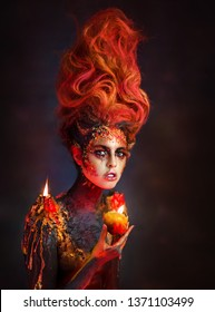 Bright beautiful girl fire. The girl in the image of fire with red hair. Fantasy image element fire. The girl in the form of a volcanic eruption