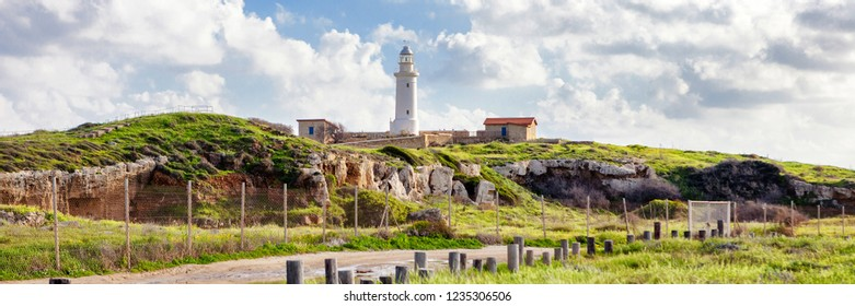 Bright beautiful scenery, an old lighthouse on the shore of the Mediterranean Sea, Cyprus, Paphos. A popular destination for summer holidays and vacations, banner panorama format