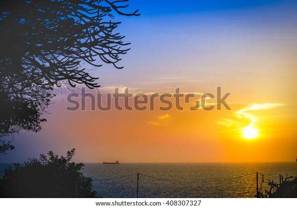 Bright and beautiful sunset sky over the sea at Koh Sichang (Sichang Island), Chonburi, Thailand.