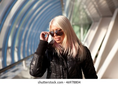 bright beautiful young girl with fashion sunglasses