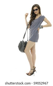 bright beautiful young woman with fashion sunglasses and handbag