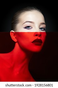 Bright beauty makeup woman with red transparent film on her face. Perfectly clean skin and face makeup, dark lipstick on plump lips