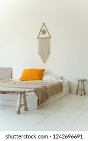 bright bedroom in a modern style, natural materials