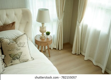 bright bedroom with side table lamp decorated in country style