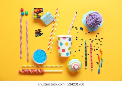 Bright birthday background with sweets and decorations