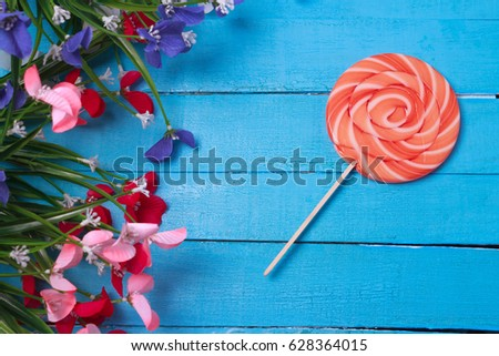 Bright Birthday Background With Sweets And Decorations Lollipop On Turqiouse Flowers