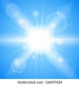 Bright blue background. Winter sun burst with lens flare
