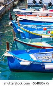 Bright blue boats in the port, Cinque Terre, Liguria province, Italy.