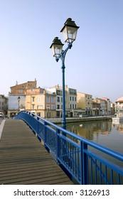 Bright blue bridge crosses the Etang de Berre in Martigues, France.