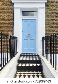 Bright blue door on a house in London, UK