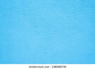 Bright blue fine texture of plaster. Background.