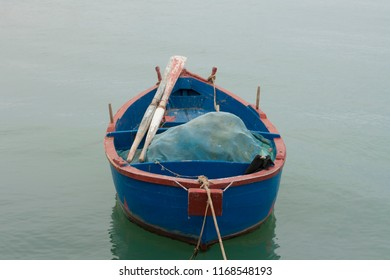 Bright blue fisherman boat on the surface of the sea