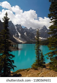 The bright blue glacial melt water of Moraine Lake in the Valley of the Five Peaks in Banff National Park, Alberta, Canada.
