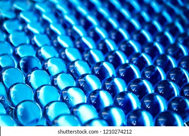 Bright blue hydrogel round shape. Macro gel balls. The concept purity, clean, transparent, ideal and perfect. Beautiful classic abstract holiday background. Perspective geometry wallpaper
