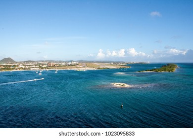 Bright blue ocean and boats off the coast of the island of Aruba