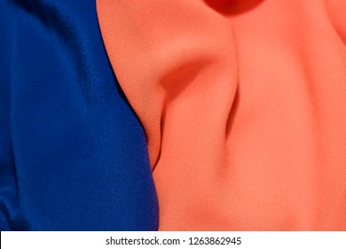 bright blue and orange fabric texture background, wavy fabric color luxury satin fabric texture