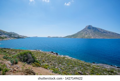 bright blue sea green hills and hills Island Telendos on the horizon in Greece Island Kalymnos