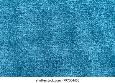Bright blue seamless generic carpet texture shot from above.