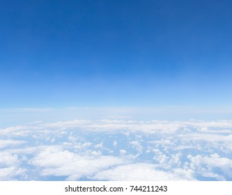 Bright blue sky above the clouds.