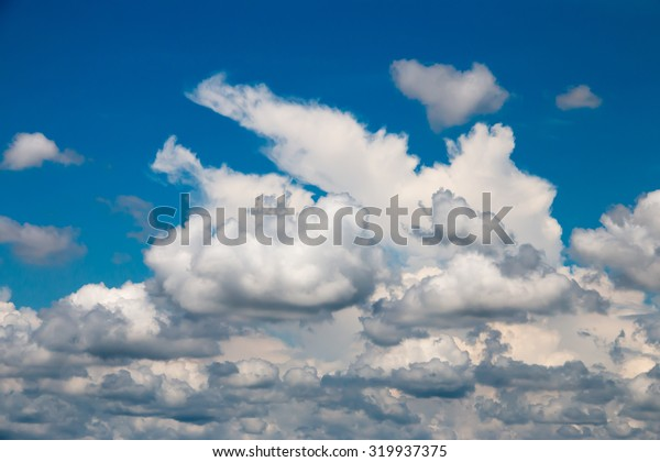Bright blue sky with fluffy white clouds