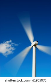 Bright blue sky moving and wind turbine