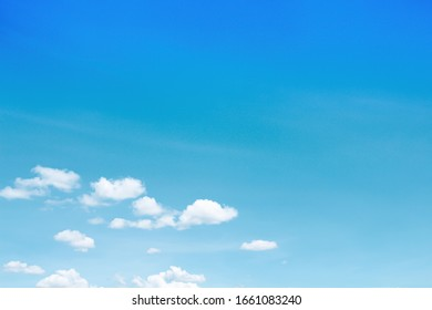 Bright blue sky with small clouds moving along the wind , summer day background and copy space