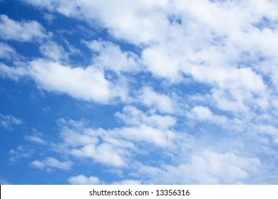 The bright blue sky with white air clouds.