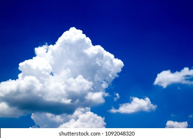 Bright blue sky, white clouds floating in the sky.