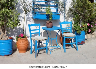 Bright blue wooden chairs in the Greek village of Adele on the island of Crete