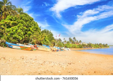 Bright boats on the tropical beach of Bentota, Sri Lanka on a sunny day